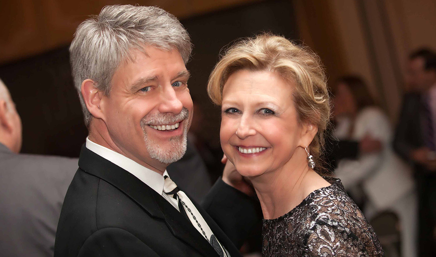 A portrait of Bill and Debra Brown at a formal event.